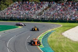 Fernando Alonso, McLaren MCL32, leads Nico Hulkenberg, Renault Sport F1 Team RS17, and Esteban Ocon,