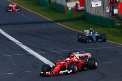 Sebastian Vettel, Ferrari SF70H, leads Valtteri Bottas, Mercedes AMG F1 W08, and Kimi Raikkonen, Ferrari SF70H
