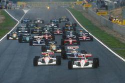 Start: Gerhard Berger, McLaren MP4/6 Honda leads Ayrton Senna, McLaren MP4/6 Honda, Nigel Mansell, W