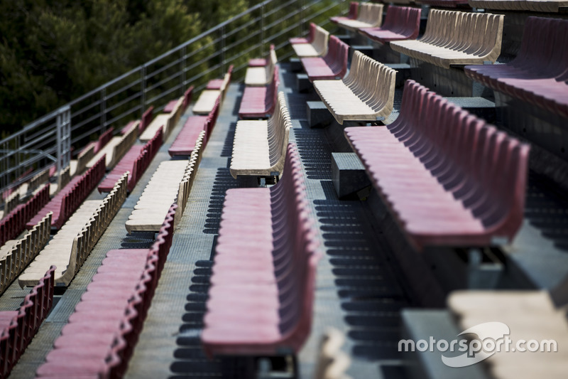 Rows of empty seats in a grandstand