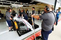 Paul di Resta prepares to exit his pit garage