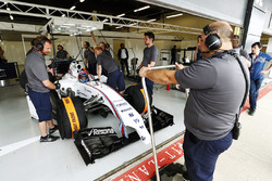 Paul di Resta prepares to exit his pit garage