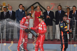 Kimi Raikkonen, Ferrari, race winner Sebastian Vettel, Ferrari and Daniel Ricciardo, Red Bull Racing celebrate on the podium with the champagne