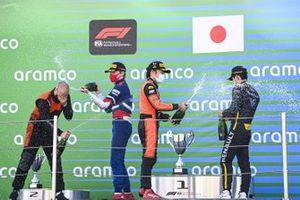 Robert Shwartzman, Prema Racing, 2nd position, Nobuharu Matsushita, MP Motorsport, 1st position, and Guanyu Zhou, UNI-VIRTUOSI, 3rd position, on the podium with Champagne
