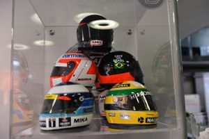 Helmets of past McLaren champions, James Hunt, 1976, Emerson Fittipaldi, 1972 and 1974, Ayrton Senna, 1988, 1990 & 1991, Mika Hakkinen, 1998 and 1999, Nikki Lauda 1984, at the McLaren 50th anniversary reception