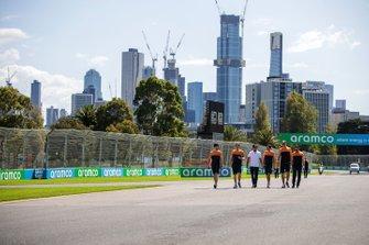 Carlos Sainz Jr., McLaren and members of the team walk the track