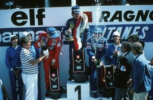 Podium: Third place Niki Lauda, McLaren, Race winner Keke Rosberg, Williams, second place Alain Prost, Renault