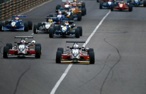 Takuma Sato, Carlin Motorsport Dallara Mugen Honda F300 leads Narain Karthikeyan at the start