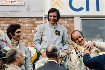 Emerson Fittipaldi celebrates victory with François Cevert, 2nd position and Denny Hulme, 3rd position