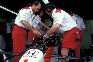 Mechanics work on the car of Ayrton Senna, McLaren MP4-7A Honda