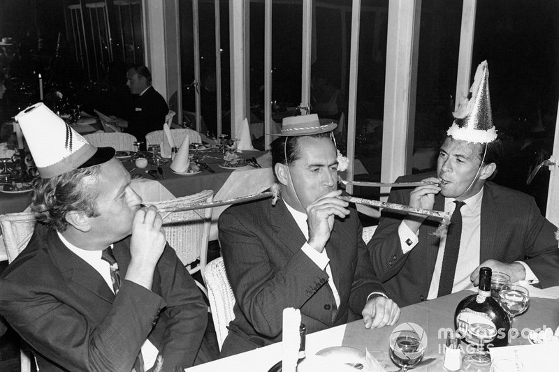 Colin Chapman, Jack Brabham and Jim Clark celebrate New Year's together