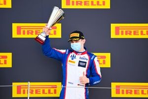 David Beckmann, Trident celebrates on the podium with the trophy