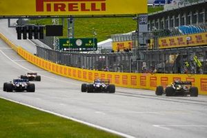 Lando Norris, McLaren MCL35, leads Sergio Perez, Racing Point RP20, Lance Stroll, Racing Point RP20 and Daniel Ricciardo, Renault F1 Team R.S.20 at the finish