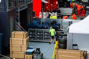 The teams pack their equipment in the paddock