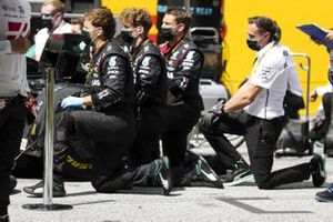 Mercedes mechanics take a knee