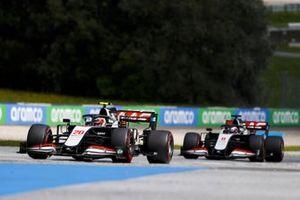 Kevin Magnussen, Haas VF-20, leads Romain Grosjean, Haas VF-20
