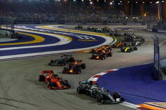 Lewis Hamilton, Mercedes AMG F1 W10, leads Sebastian Vettel, Ferrari SF90, Max Verstappen, Red Bull Racing RB15, Valtteri Bottas, Mercedes AMG W10, Alexander Albon, Red Bull Racing RB15, Carlos Sainz Jr., McLaren MCL34, and the remainder of the field at the start