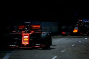 Sebastian Vettel, Ferrari SF90, leads Max Verstappen, Red Bull Racing RB15