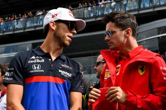 Pierre Gasly, Toro Rosso, talks with Charles Leclerc, Ferrari