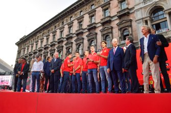Former Ferrari F1 drivers and personnel gather on stage with the Ferrari Academy drivers