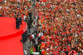 Former Ferrari F1 drivers gather on the stage in front of the crowd