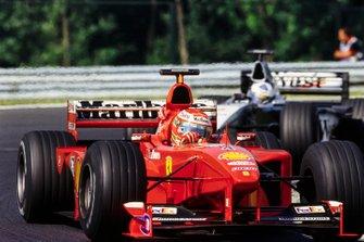 Eddie Irvine, Ferrari and David Coulthard, McLaren
