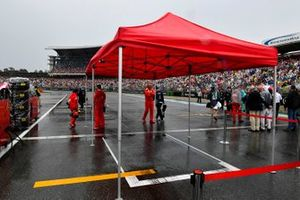 Ferrari mechanics wait around their awning for Sebastian Vettel, Ferrari SF90