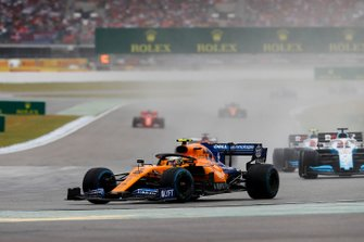 Lando Norris, McLaren MCL34, leads George Russell, Williams Racing FW42, and Robert Kubica, Williams FW42