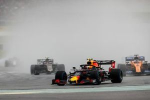 Pierre Gasly, Red Bull Racing RB15, leads Carlos Sainz Jr., McLaren MCL34, and Kevin Magnussen, Haas F1 Team VF-19