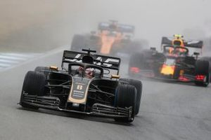 Romain Grosjean, Haas F1 Team VF-19, leads Pierre Gasly, Red Bull Racing RB15, and Carlos Sainz Jr., McLaren MCL34