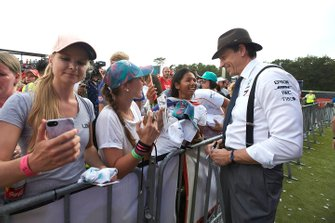 Toto Wolff, Executive Director (Business), Mercedes AMGsigns an autograph for a fan