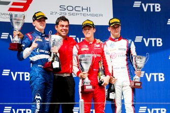 Robert Shwartzman, PREMA Racing, Marcus Armstrong, PREMA Racing and Niko Kari, Trident on the podium with the trophy