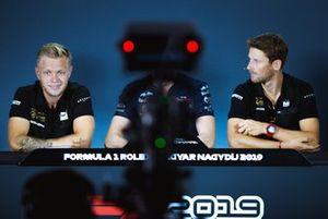 Kevin Magnussen, Romain Grosjean, Haas F1 Team at press-conference