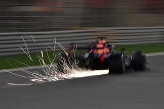 Sparks fly from the rear of Max Verstappen, Red Bull Racing RB15