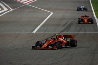 Charles Leclerc, Ferrari SF90, leads Sebastian Vettel, Ferrari SF90, and Valtteri Bottas, Mercedes AMG W10