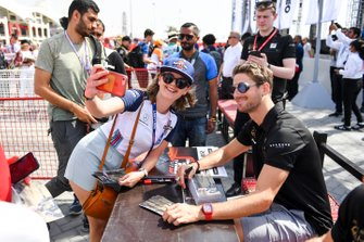Romain Grosjean, Haas F1 poses for a selfie with a fan