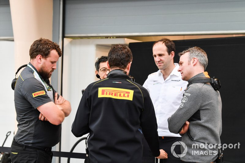 Pirelli staff talking to McLaren