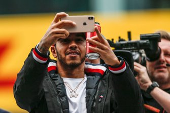 Lewis Hamilton, Mercedes AMG F1, takes a photo at the drivers parade