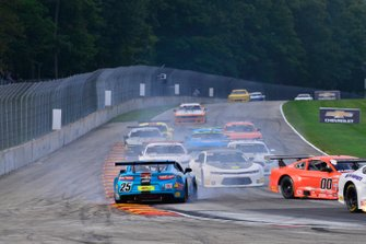 #25 TA2 Chevrolet Camaro driven by Mikhail Goikhberg of BC Race Cars spins mid-pack during the TA2 race at Road America
