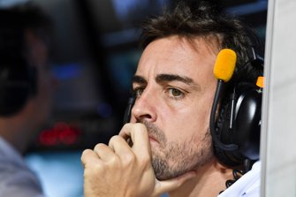 Fernando Alonso on the McLaren pit wall during Qualifying