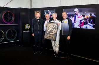 Chase Carey, Chairman, Formula 1, Damon Hill and Mario Isola, Racing Manager, Pirelli Motorsport, present the official F1 1000 poster