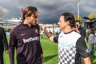 Roma player Francesco Totti, greets Felipe Massa, Venturi Formula E