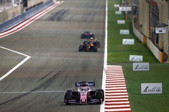 Sergio Perez, Racing Point RP19, leads Kevin Magnussen, Haas F1 Team VF-19