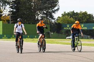 Lando Norris, McLaren, cycles the track