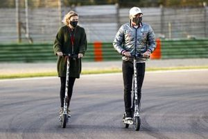 Valtteri Bottas, Mercedes-AMG F1, rides the track on a scooter with girlfriend Tiffany Cromwell