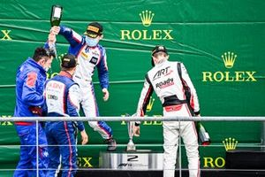 David Beckmann, Trident, Race Winner Lirim Zendeli, Trident and Theo Pourchaire, ART Grand Prix celebrate on the podium with the champagne