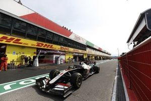 Romain Grosjean, Haas VF-20, in the pit lane
