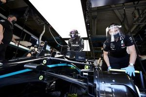 Lewis Hamilton, Mercedes-AMG F1, settles into his seat