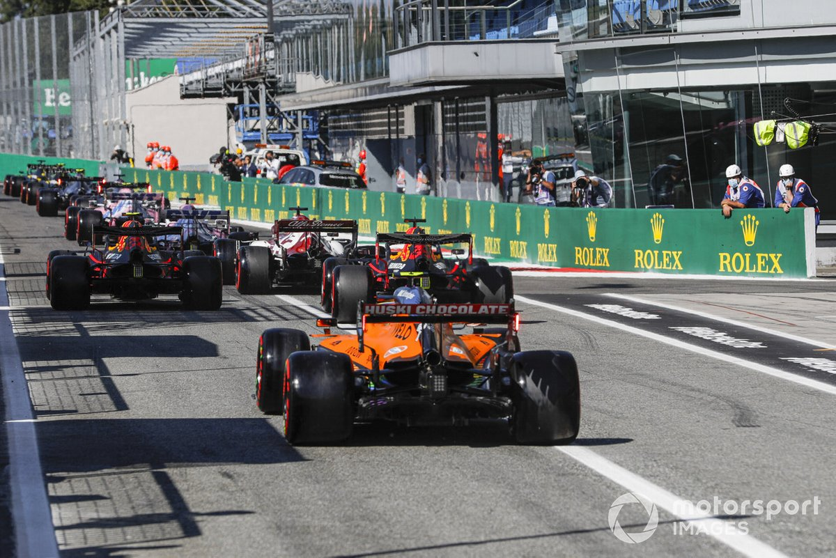 Alex Albon, Red Bull Racing RB16, Max Verstappen, Red Bull Racing RB16, and Lando Norris, McLaren MCL35, to the cicruit