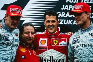 Mika Häkkinen, 2nd position, Jean Todt, Team Principal, Ferrari, Michael Schumacher, 1st position, and David Coulthard, 3rd position, on the podium